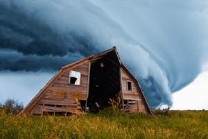tornado behind a barn